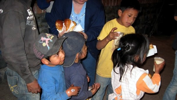 Children gather to eat at our Soup Kitchen.